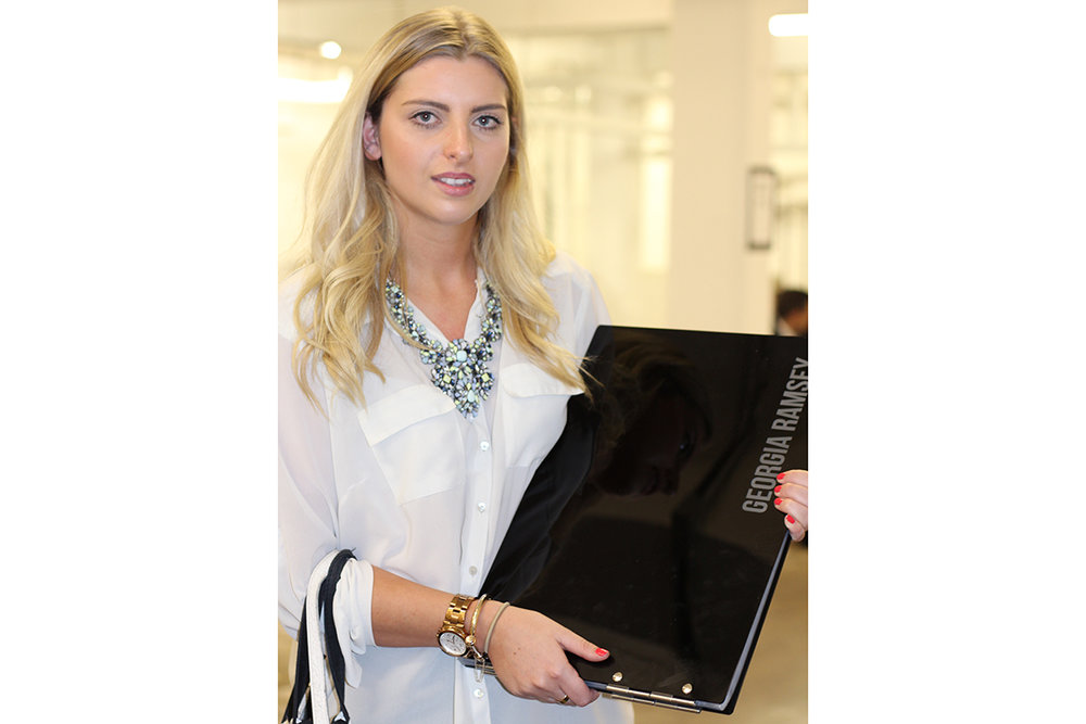 student and her Folio black perspex A3 landscape portfolio at Graduate Fashion Week