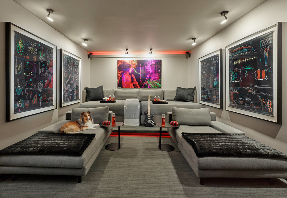 Before after a typical garage becomes a vibrant home theater