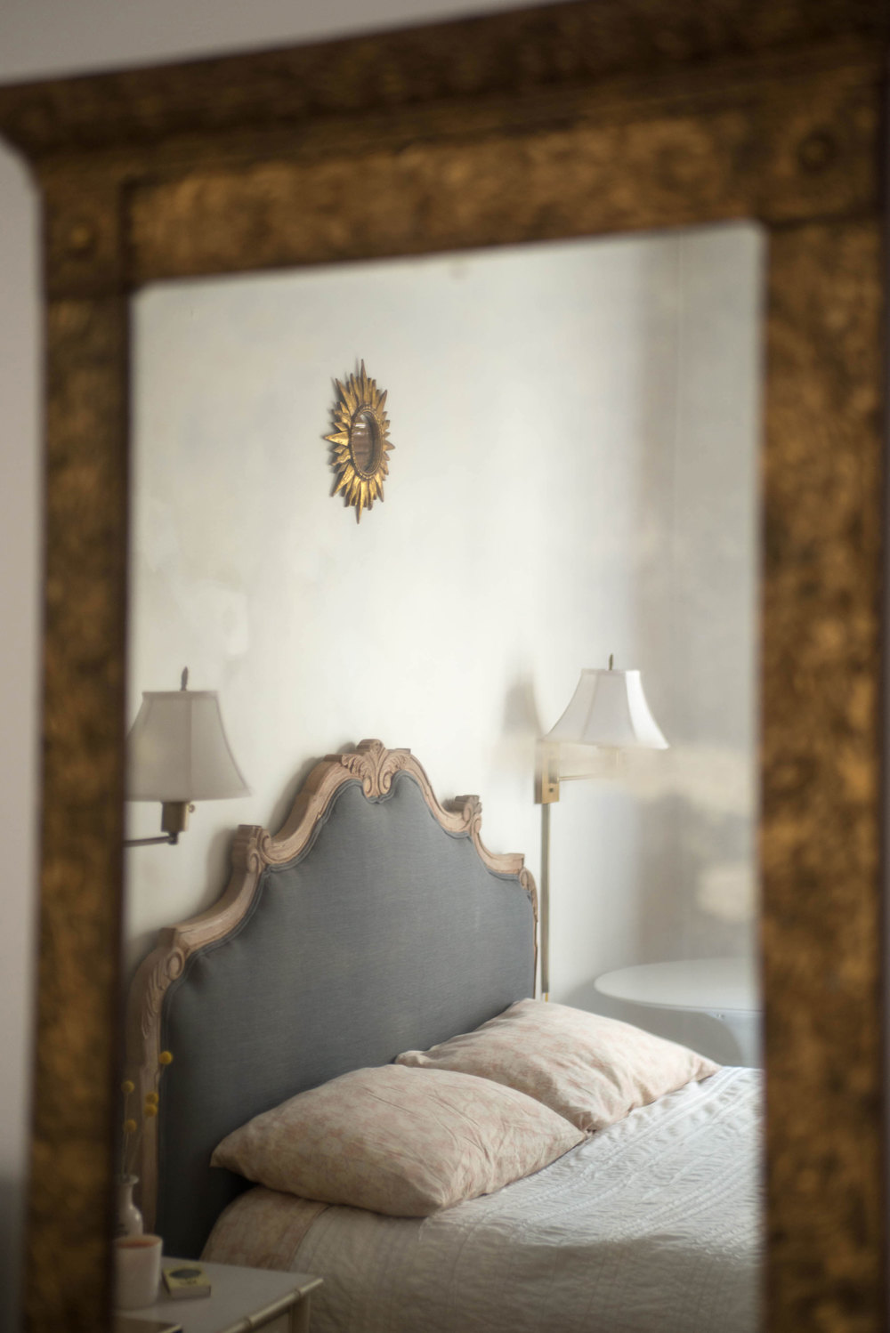 A view of the bed through the mirror I have hung over my dresser | Photograph by: Lauren L Caron © 2016