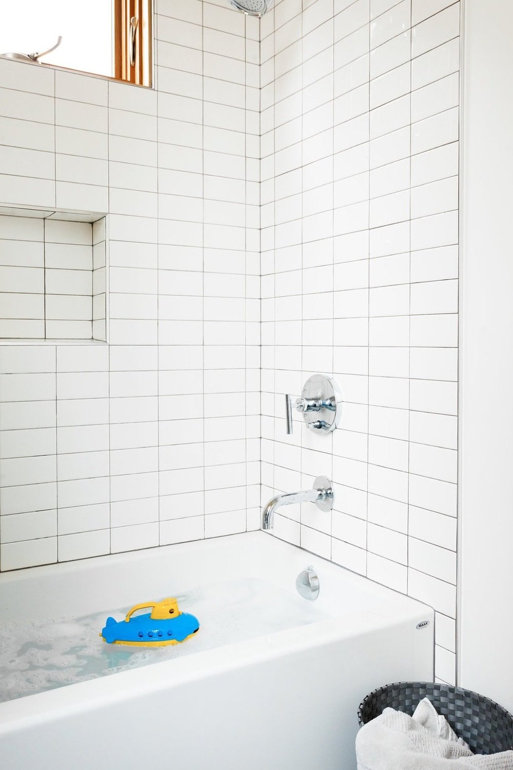 cost-effective-subway-tile-has-been-used-in-the-kids-bathrooms.jpg