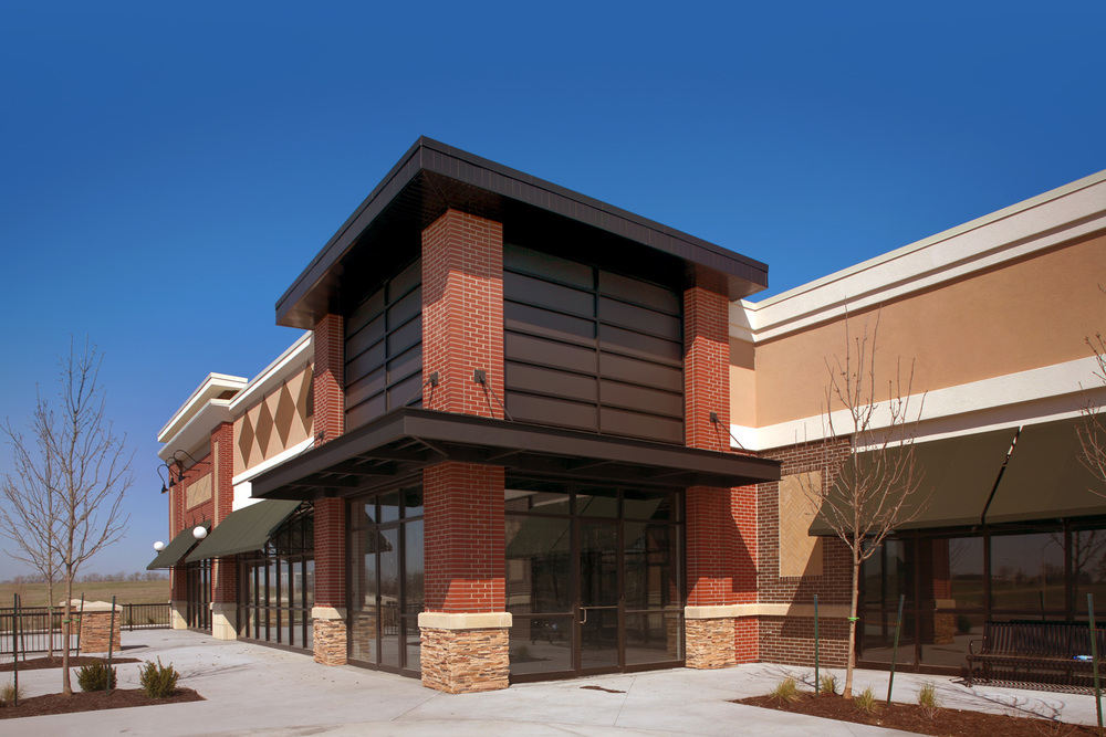 Contemporary Lines And Clean Brick Detailing Along With A Stone Base Define The Crisp Styling Of Shops At Sunnybrook This Neighborhood Center Is
