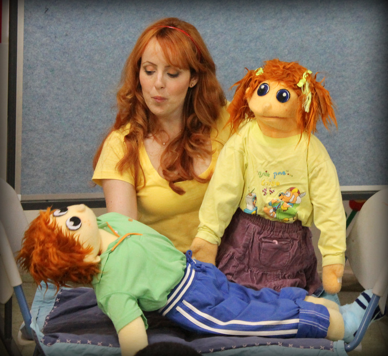 Using puppets, Yael learns the difference between good touch and bad touch.