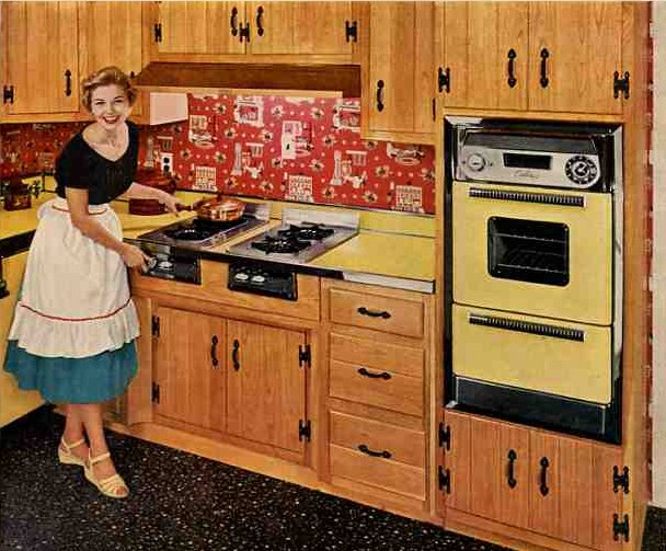 "WAY BEFORE: The vintage ""Caloric kitchen"" with planked oak cabinets reminiscent of those in the Perl Residence"