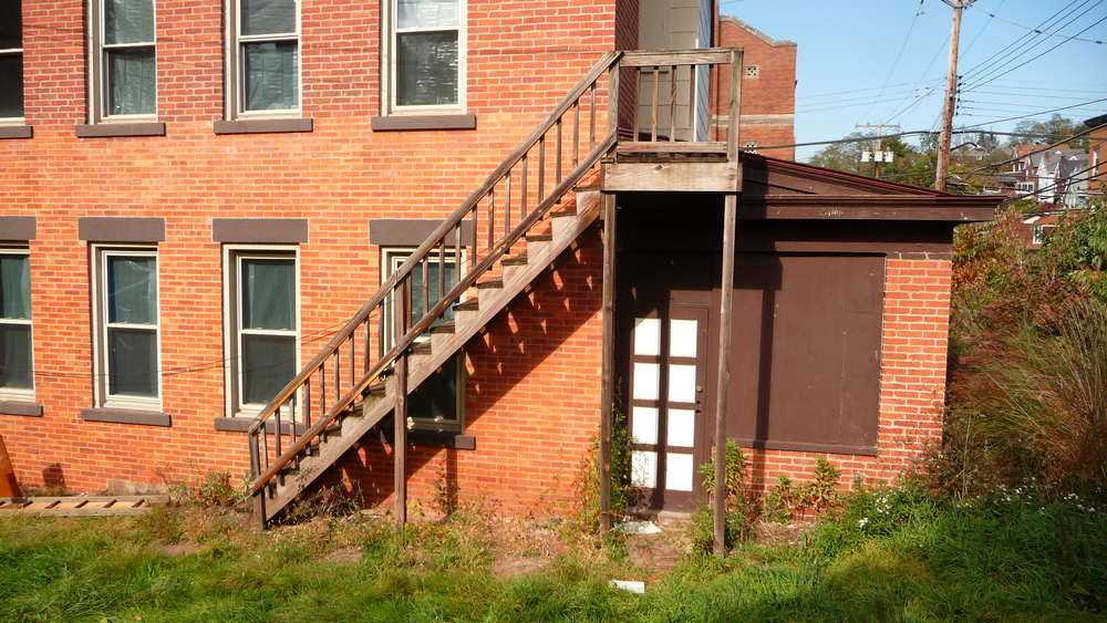 BEFORE: Existing non-compliant egress stair