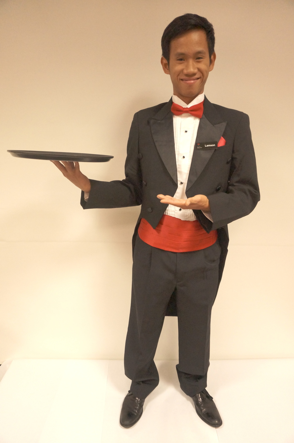 Formal Uniform: Tuxedo jacket with tails, white tuxedo shirt, red bow tie, red cumberbund, cufflinks, tuxedo buttons, and black shoes