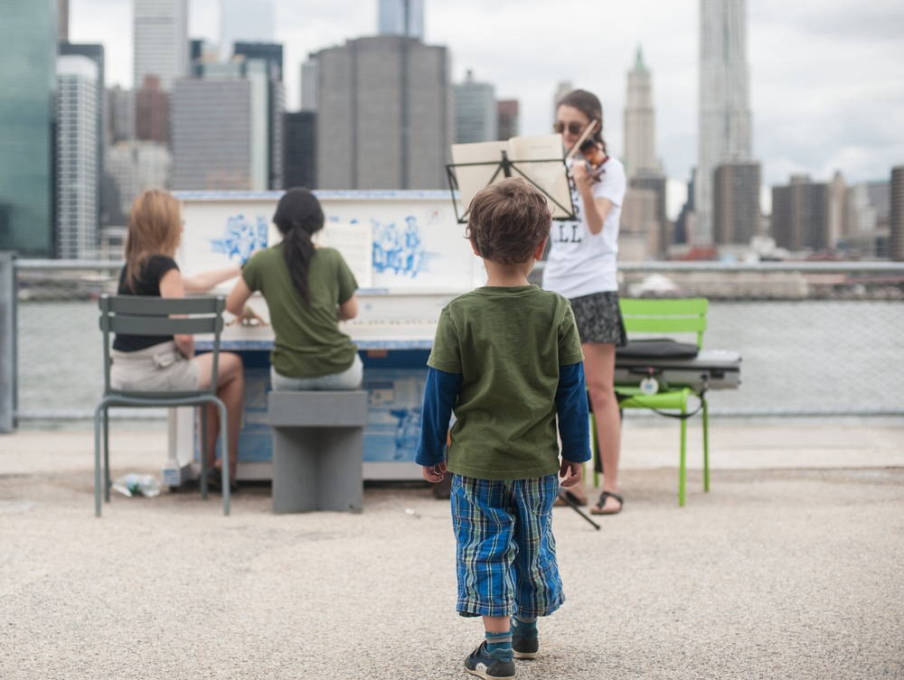 Kid Watching a Sing for Hope Piano Concert on the Brooklyn Height Promenade