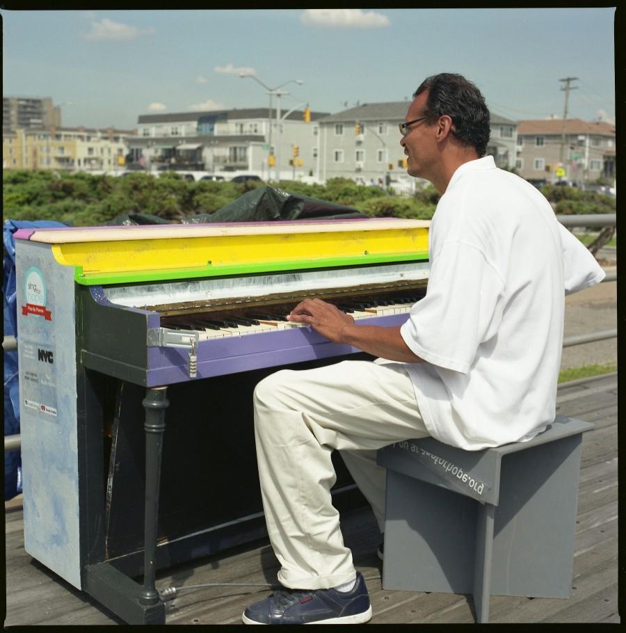 Sing for Hope Piano-Man-at-Rockaway-Beach-Hasselblad-and-Fuji-Reala-100
