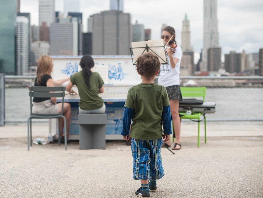 Boy Stopping to Watch the Action at Brooklyn Bridge Park, Brooklyn
