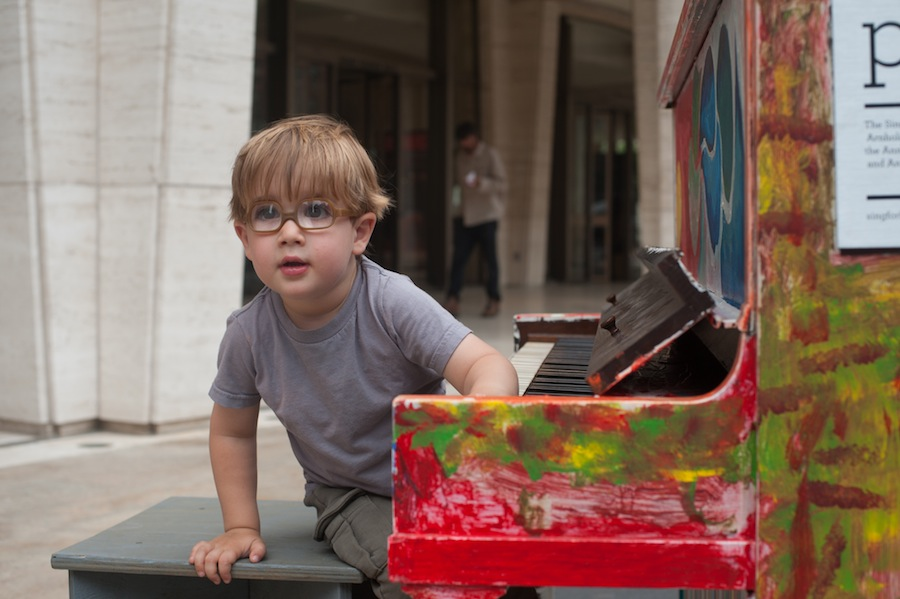 Boy at Sing for Hope Piano in Lincoln Center