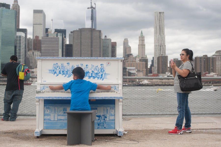Boy at Stefan's Sing for Hope Piano with Lower Manhattan in the Background, Brooklyn Bridge Park
