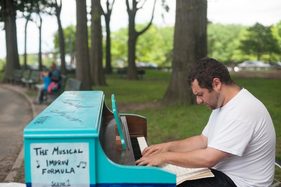 Man Playing Brad's Sing for Hope Piano in Astoria Park