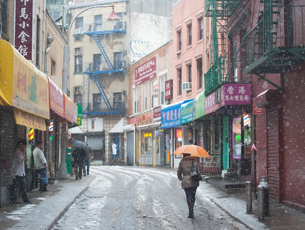Woman with Oragne Umbrella Walking on Doyers Street, Chinatown, NYC