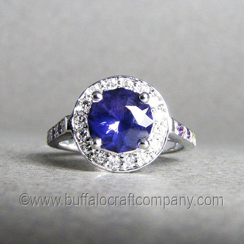 """""""Massey"""" 14k white gold women's haloengagement ring This classic halo rings features a round center sapphire surrounded by a circle (halo) of smaller accent diamonds."""
