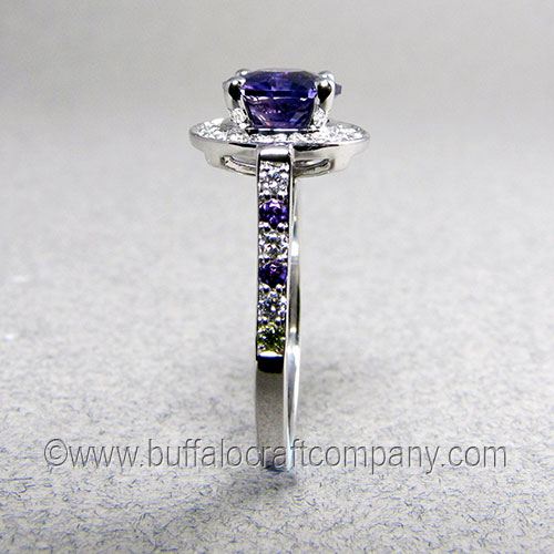 """""""Massey"""" 14k white gold women's haloengagement ring We chose to use a sapphire for its strength as the center stone, however we were able to incorporate our clients birthstones, amethyst and peridot in the ring shank."""