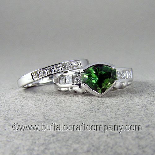 """""""Elizabeth"""" 14k white gold Irish Claddagh women's engagement ring Irish Claddagh engagement ring is made from 14k white gold. The center stone isa 1.73ct green tourmaline. Six channel set diamonds are set on either side of the center stone. The wedding band is fabricated out of 14k white gold and includes 7 pave set diamonds."""