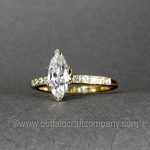 """""""Laura"""" 18k yellow gold custom engagement ring with Marquise diamond. One of the oldest diamond cuts, this classic Marquise setting holds a prong set VVS1 D color .57ctMarquise diamond. 5, 1.5mm VS G-H diamond melee are bead set along each side of the18k gold ring shank."""