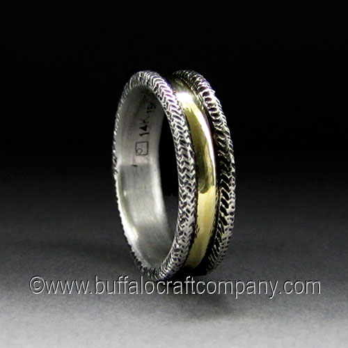 """""""Colleen"""" Hand fabricated and engraved from 14k white and yellow gold."""