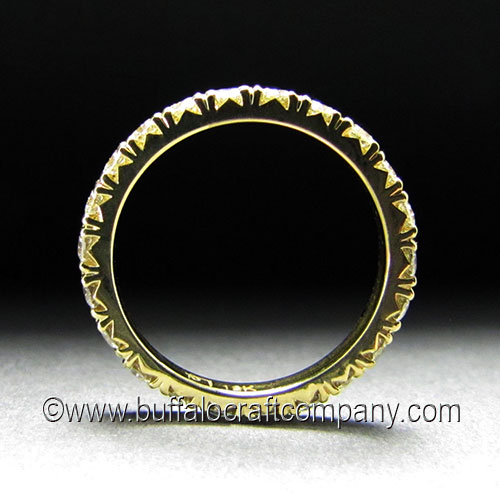 """""""Laura"""" 18k yellow gold woman's wedding band We love the side profile of the french set diamonds, it adds even more elegance to this already beautiful piece."""