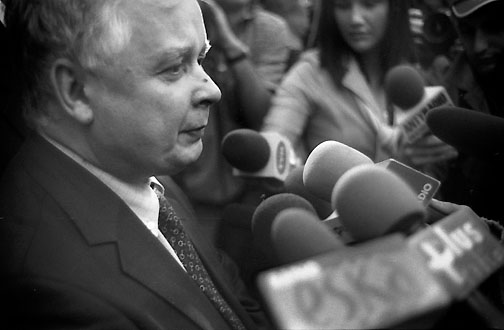 [Warsaw, 2005, photo © Bill Crandall]    RIP Lech Kaczynski, and all the others on the plane with him. I happened to photograph him in Warsaw the year he became president.   Of course a plane crash is always tragic for loved ones lost. Add to that a president dying, along with so many from the top levels of Polish government; that it was near Katyn forest, infamous for the 1940 massacre of thousands of Poles; that they were going there to commemorate the massacre, with relatives of the victims onboard; that it was an older Soviet-built plane. Just unbelievably cruel and profound symbolism. A cursed place, reasserting itself.   Last night, I suppose around the same time, I had a brief nightmare that I was near the top of a skyscraper when an earthquake struck. The building began to sway, then it toppled over sideways. I had a physical sensation of falling from a great height.   I wonder if earthshaking events (sorry for the pun) can have a ripple effect and penetrate our unconscious.