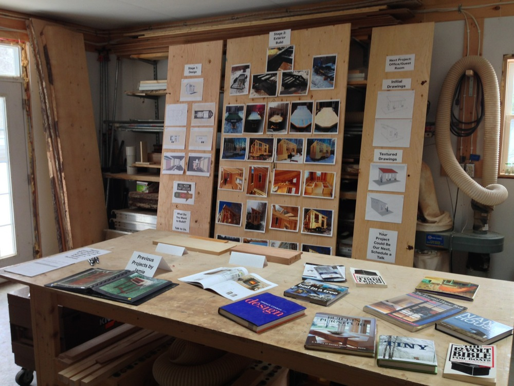 Book table, sample of cherry and ash interior wood, and design/build process