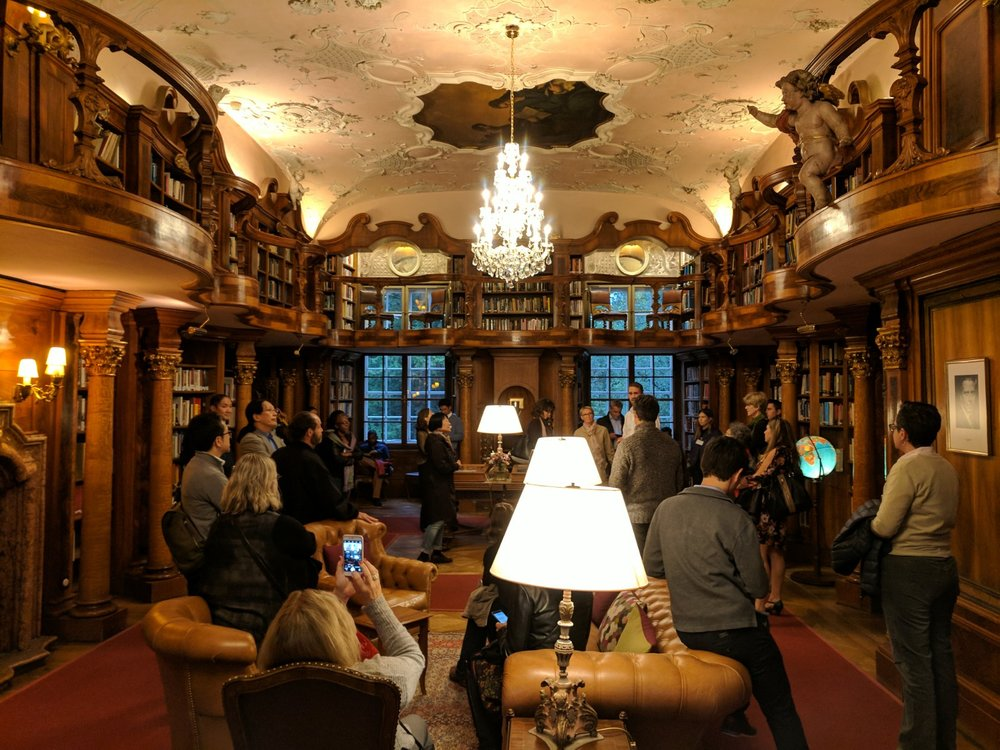 Seminar attendees in the Schlosse's incredible library.
