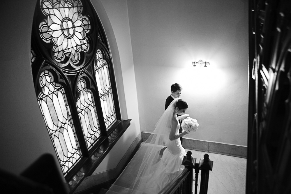 A couple make their way down the stairs right after their wedding ceremony.