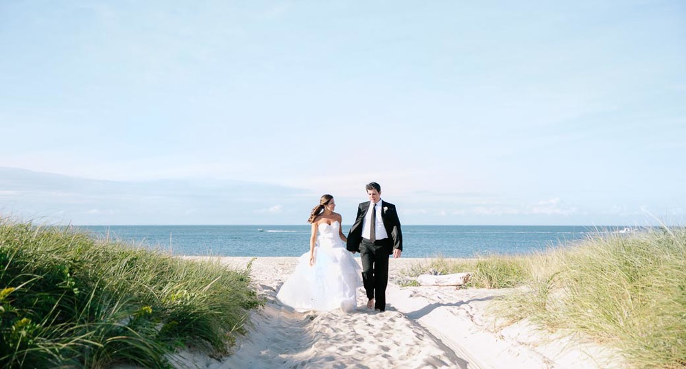 A couple share a moment as they walk from the beach in the Hamptons.