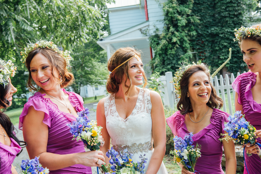 A bride and her bridesmaids at the beginning of the wedding day.
