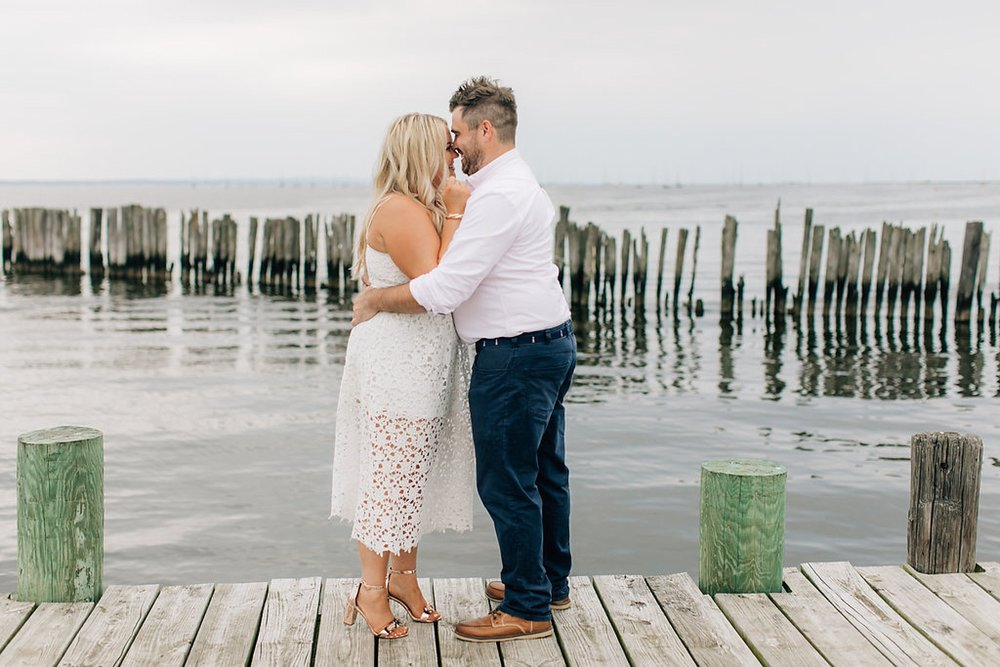 An Engagement Session by the Water in Family Boatyard with Puppy by Magdalena Studios_0004.jpg