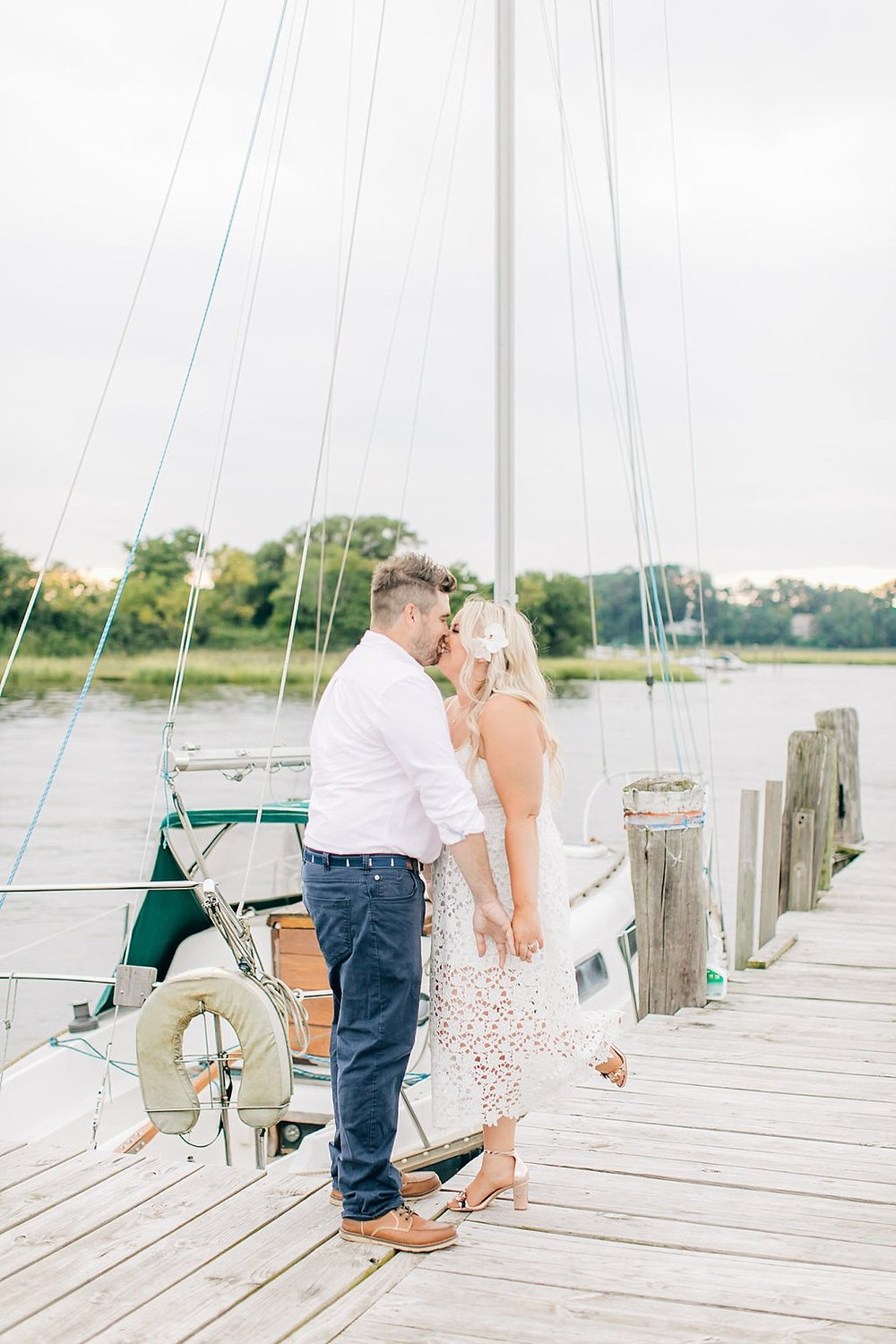 An Engagement Session by the Water in Family Boatyard with Puppy by Magdalena Studios_0007.jpg