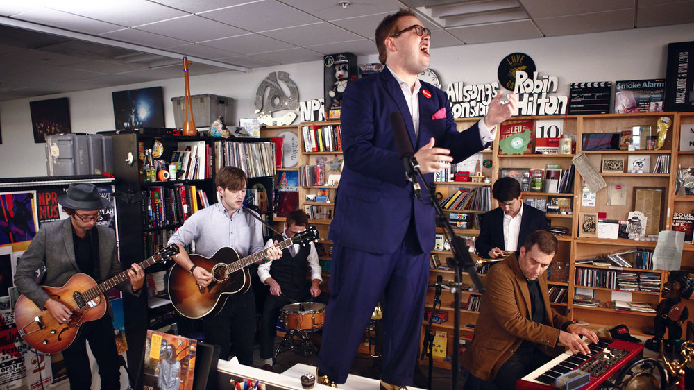"NPR:  TINY DESK   Tiny Desk Concert Contest: Over 7,000 musicians across the USA entered in a contest for a chance to perform at NPR Music's Tiny Desk and at the Lagunitas CouchTrip- pin' to Austin show. The winner this year is Fantastic Negrito — a.k.a. Xavier Dphrepaulezz, pronounced dee- FREP-ah-lez — has a remarkable backstory. For his One of 15 children, he grew up in a strict home, and later signed a contract with Interscope Records in the '90s. That deal fell apart, though, and soured him on music-making. Then, a near-fatal car crash put him in a coma, and eventually left him without the proper use of his hands; he struggled with physical therapy for years to get some movement from what he now calls ""The Claw."""