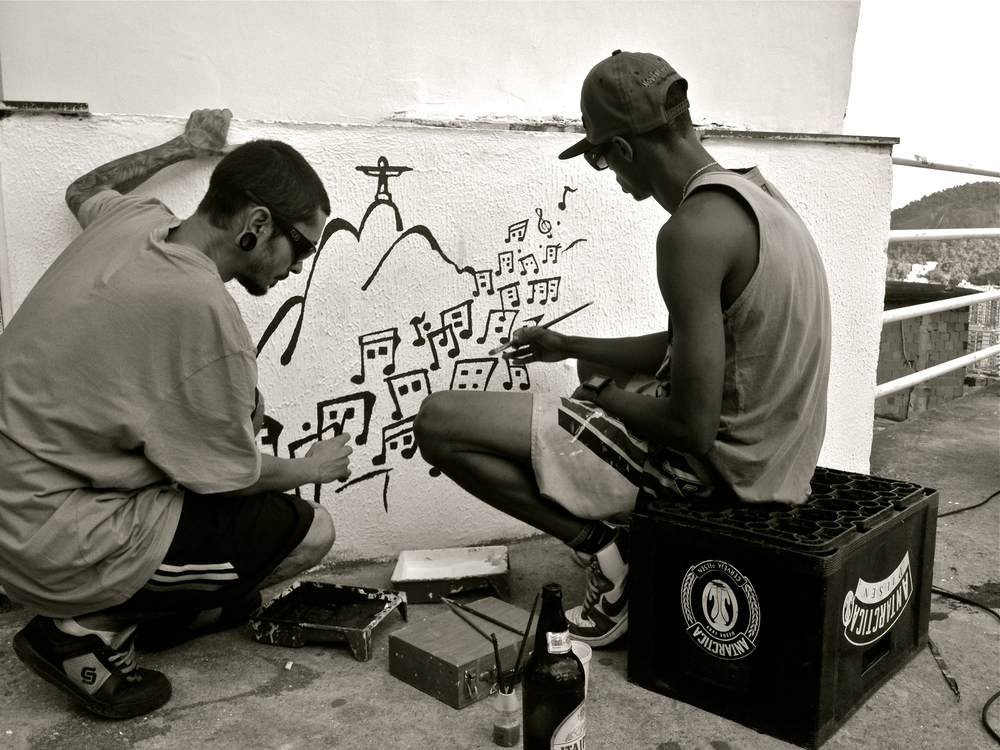 "Artists painting atop Santa Marta favela, where Michael Jackson filmed his music video ""They Don.t Care About Us."""