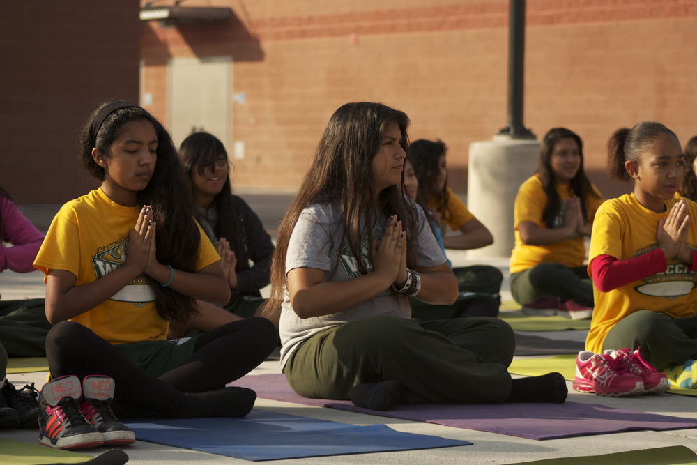 8th grade students practicing Kundalini yoga at Watts Learning Center Charter Middle School.