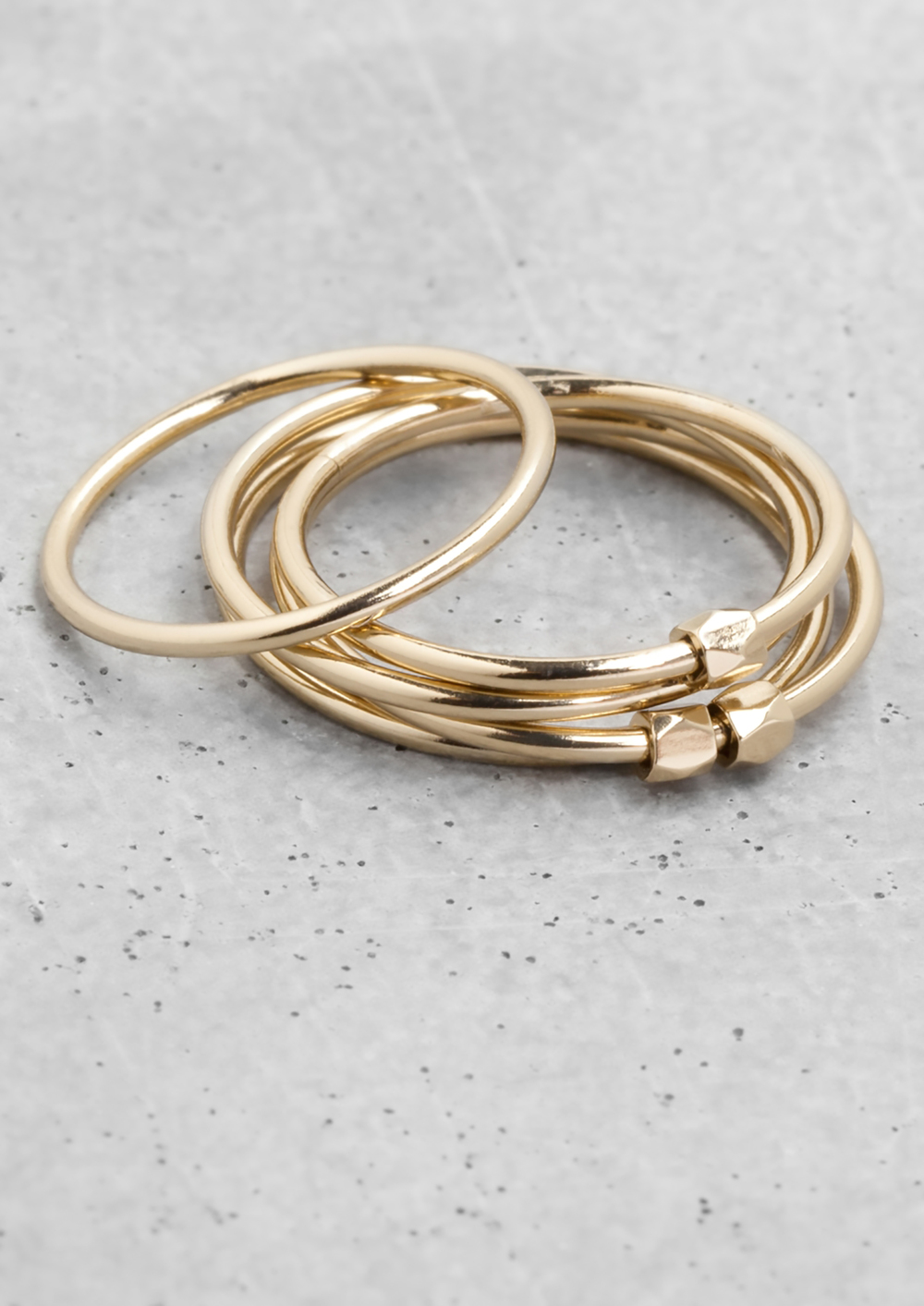 &otherstories thin brass rings 1500.jpg