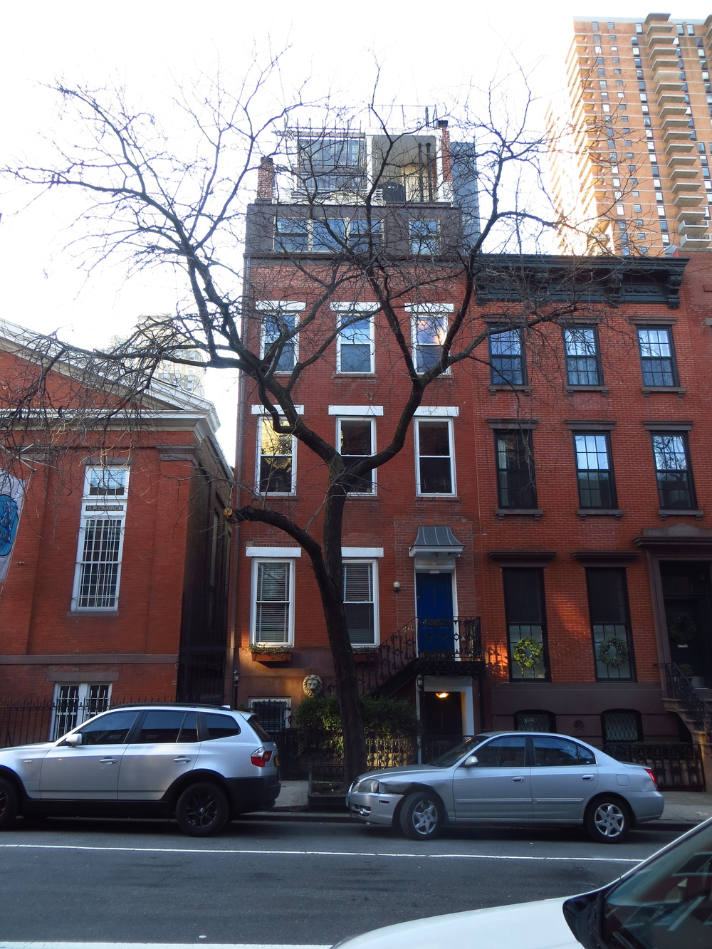 Cool row house (there's an awesome penthouse on top)
