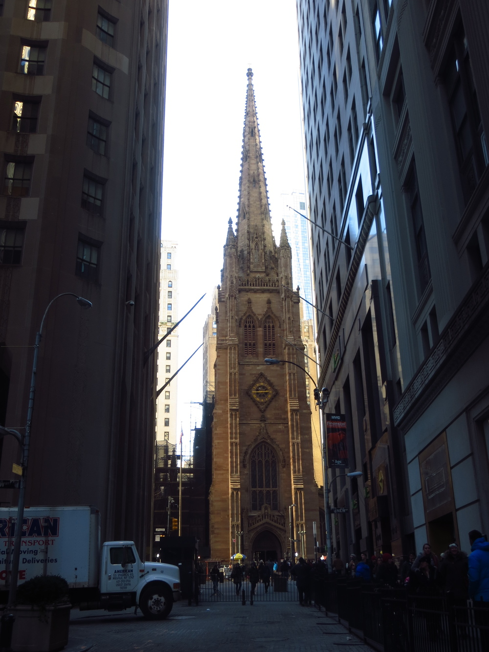 View of Trinity Church down Wall St.