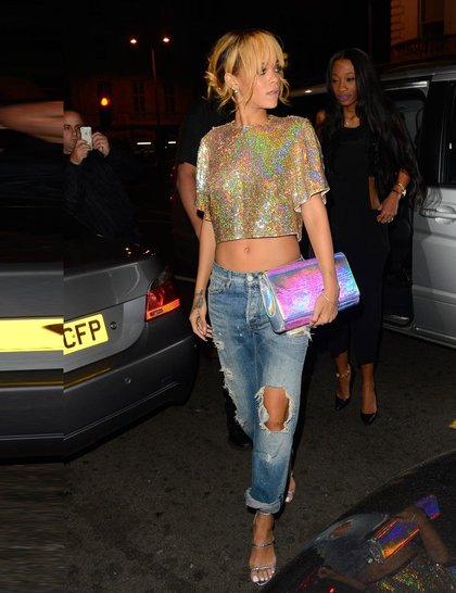 at Boujis club wearing Stella McCartney sequined crop top and a Stella McCartney hologram clutch and strappy sandals, London, June 2013.