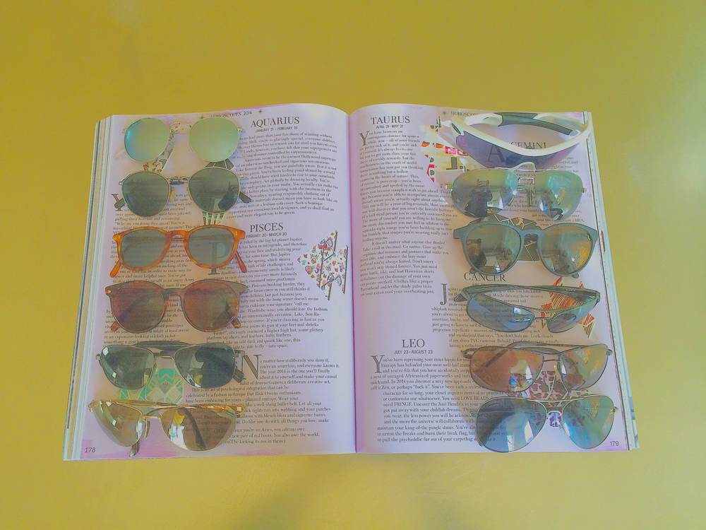 MOLLY'S COLLECTION PHOTOGRAPHED IN VOLUME 6 OF  GARAGE MAGAZINE  (LEFT COLUMN:  RAY BAN , VINTAGE GIORGIO ARMANI,  OLIVER PEOPLES , REVO, MOSLEY TRIBES, MAUI JIM. RIGHT COLUMN: OAKLEY, MAUI JIM, REVO, KAEON, OLIVER PEOPLES,  CHANEL ).