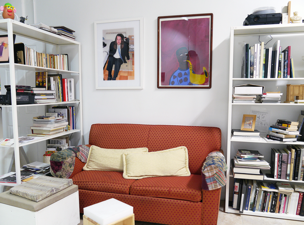 Eric Gregory Powell and Elizabeth Axtman are the two images above the couch respectively.