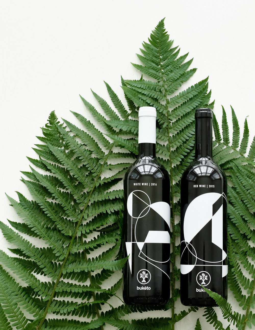 Buketo wine bottle designs by Lazy snail Design