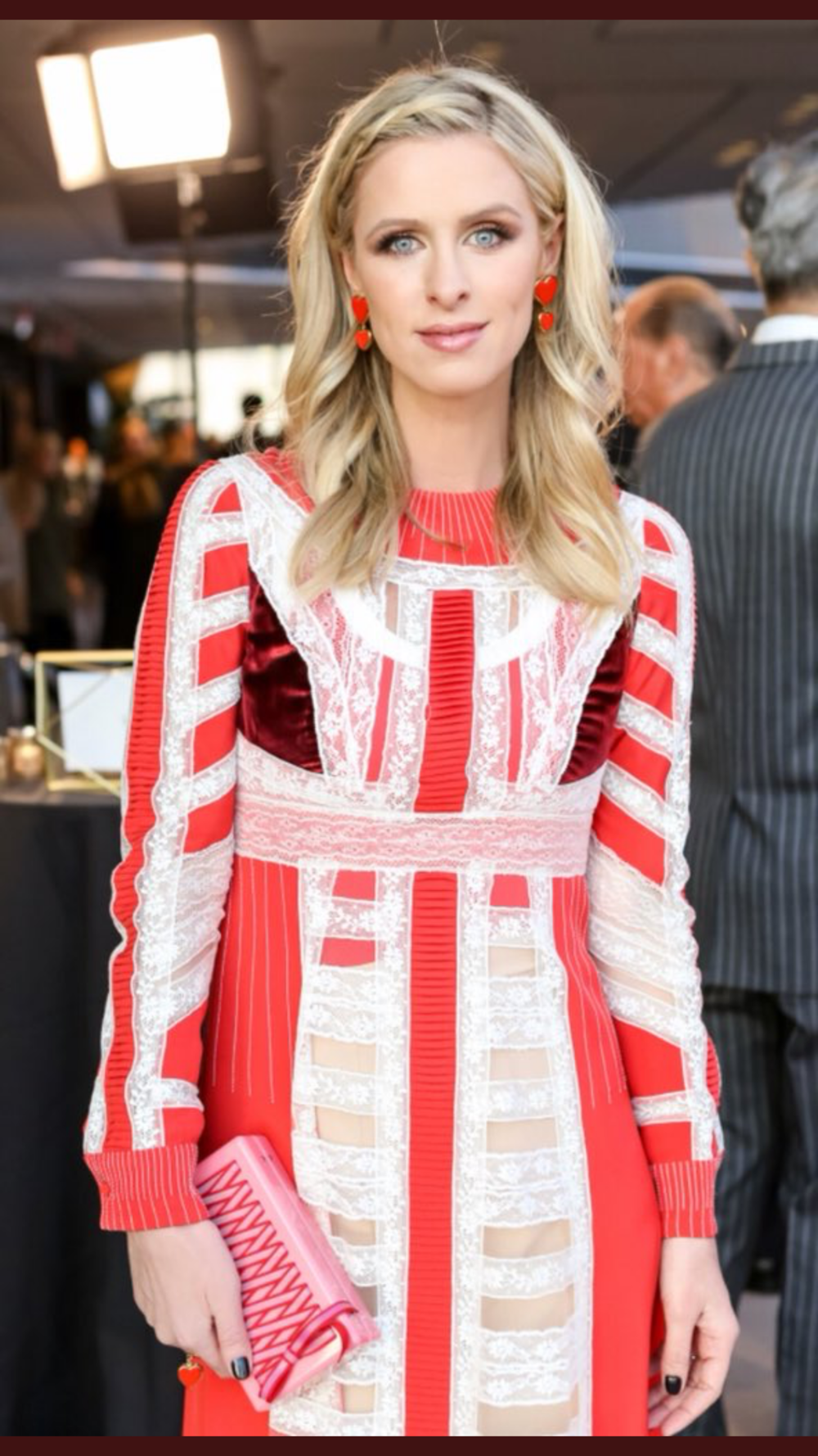 Nicky Hilton, wearing Valentino and Edie Parker