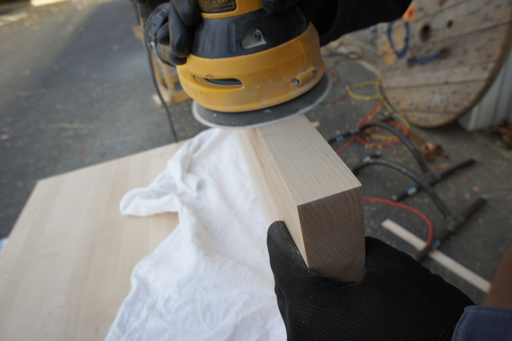 The edges are sanded with 60-120-150-220 grit sandpapers to clean up the saw marks and bring out the edge grain.