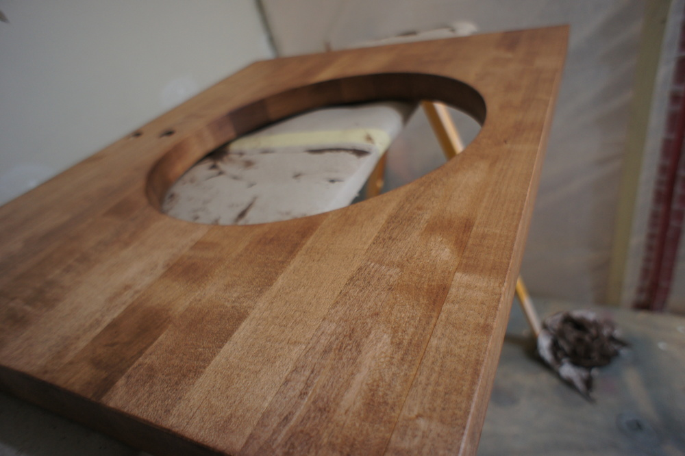 Here is a great shot of the stained vanity top. It is ready for the top-coating process.