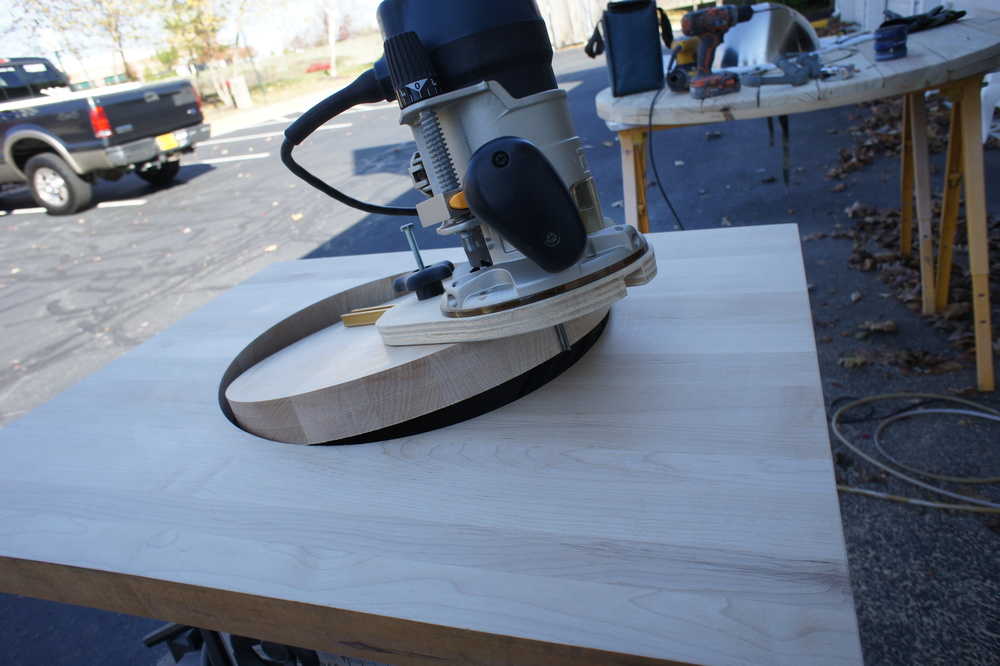 We cut the hole for the undermount sink using a router and a circle-cutting jig.