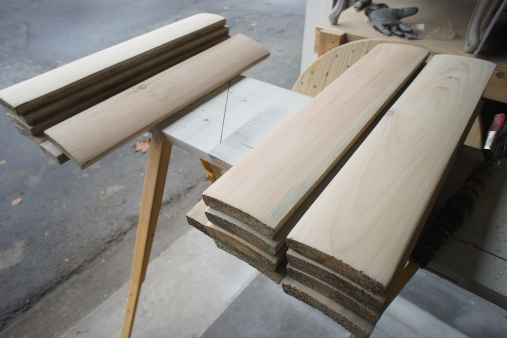 The center column is composed of segmented pine boards.