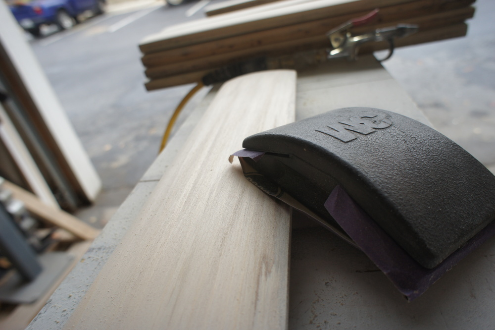 Everything is sanded with 220 grit sandpaper secured to a sanding block.