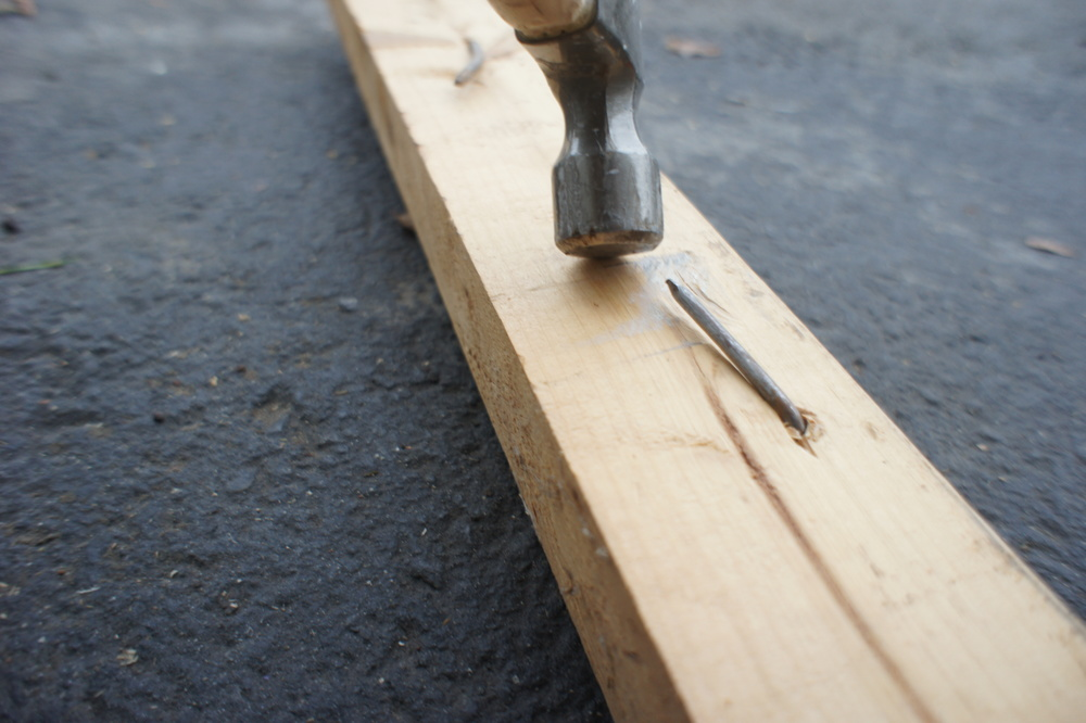 Any boards that can't be salvaged are de-nailed or cleaned by bending the existing nail heads over.