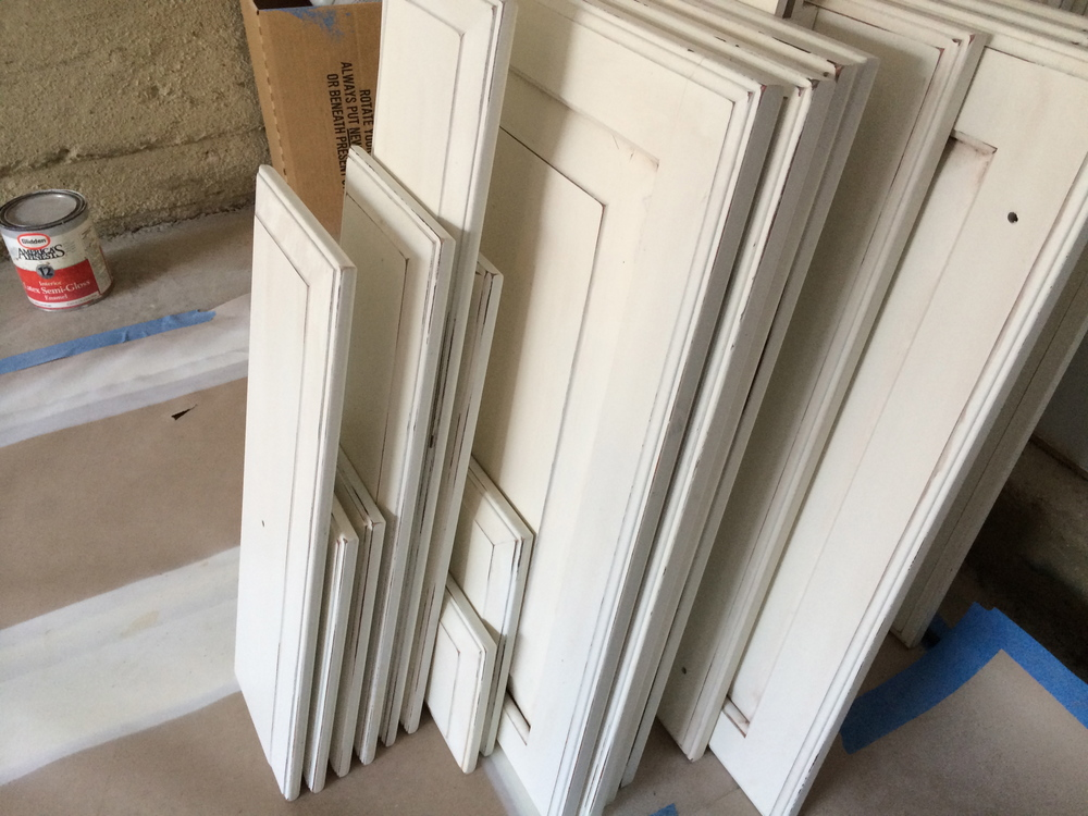 The doors and drawer fronts are stacked and ready for the final lacquer coat.