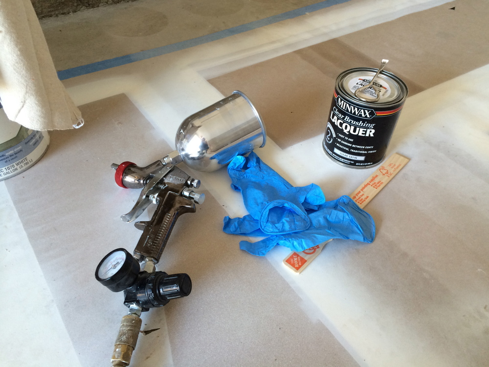 Gloves, HVLP Spray Gun, Stir Stick, and the Topcoat.