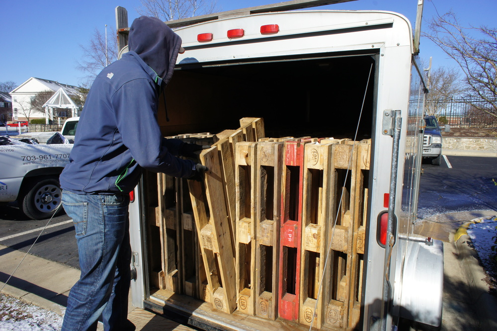 Removing pallets from the trailer.